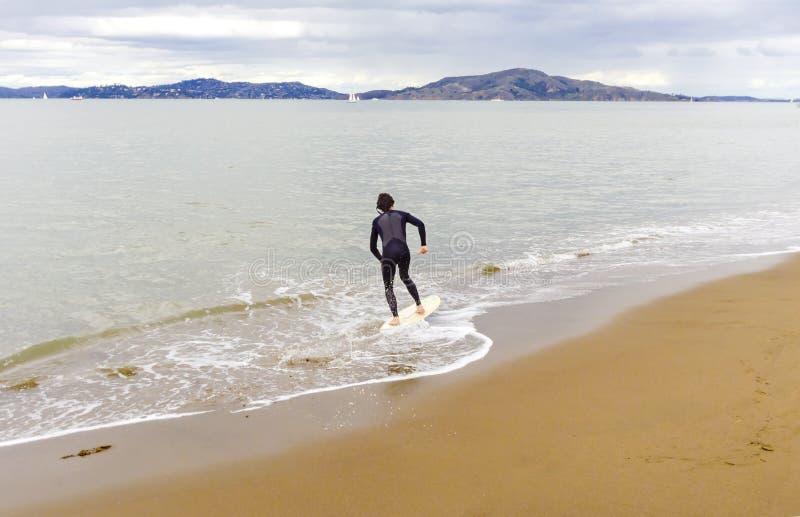 Skimboarding in San Francisco Bay, California fotografia stock