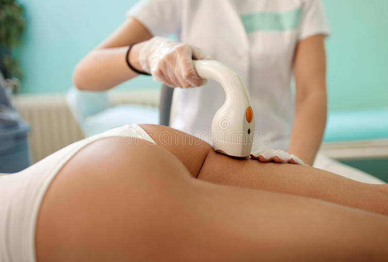 Skin and body care, epilation with laser stock images