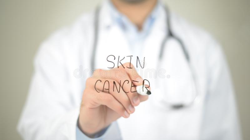 Skin Cancer , Doctor writing on transparent screen. High quality stock images