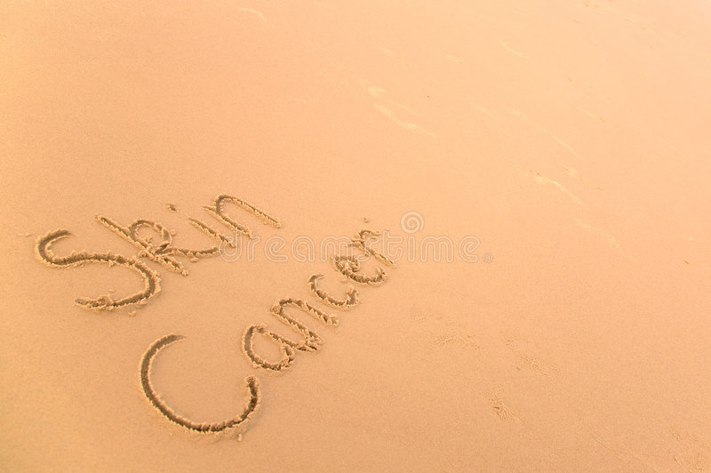 Skin cancer in sand royalty free stock photos