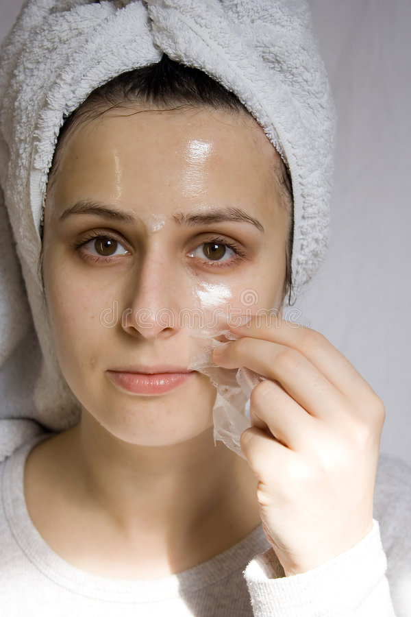 Skin care. Portrait of young woman with beauty mask stock photography