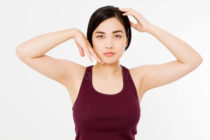 Skin care and armpit concept. Make up and cosmetics. Young asian woman on white background in summer shirt. Copy space.  stock photography