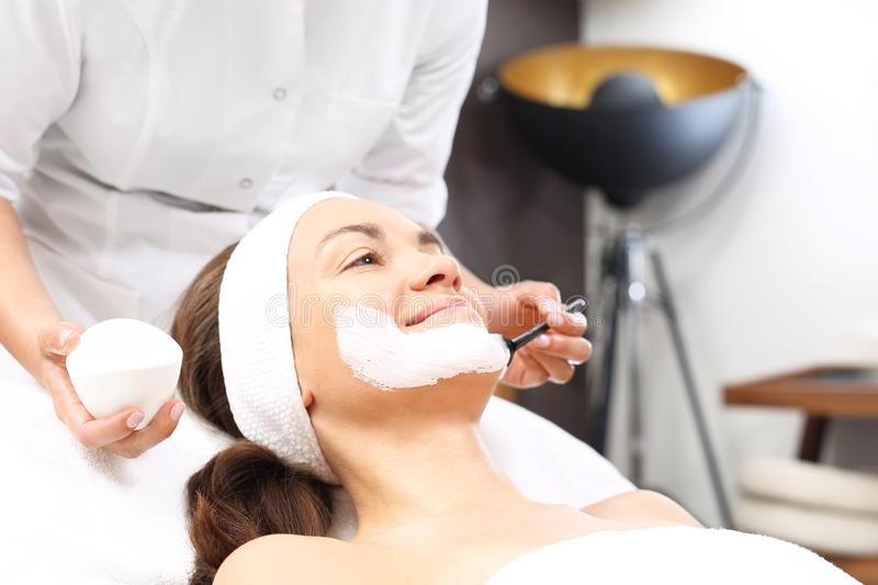 Skin care, a beautician applies a mask. royalty free stock photo