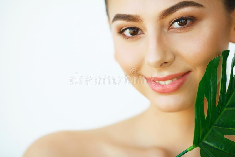 Skin Care. Beautiful Girl with Green Leaves. Beauty Treatment. C stock images