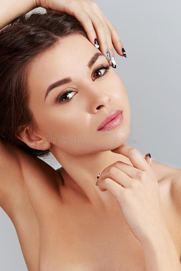 Skin care. Beauty Concept. Beautiful Young Woman with Clean Fresh Skin. Young pretty female of Smiling With Natural Makeup. stock photos