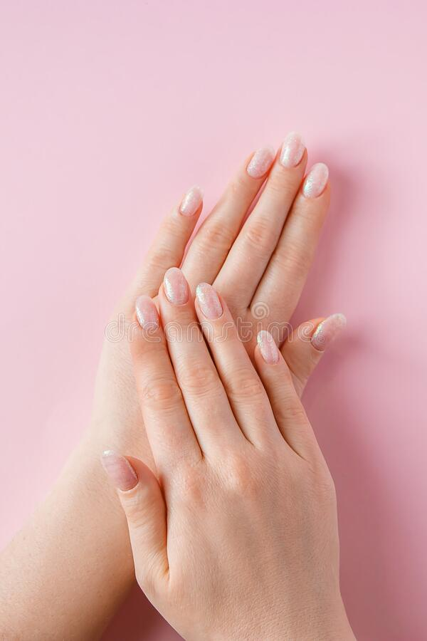 Free Skin Care Concept. Beautiful Female Hands On Pink Background. Place For Text Stock Photos - 214837003