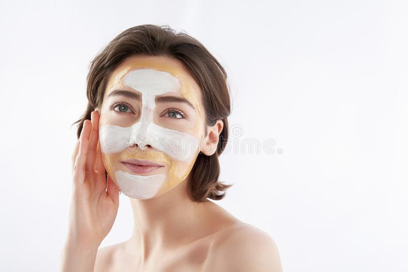 Dreamful pretty smiling woman with face mask stock photos