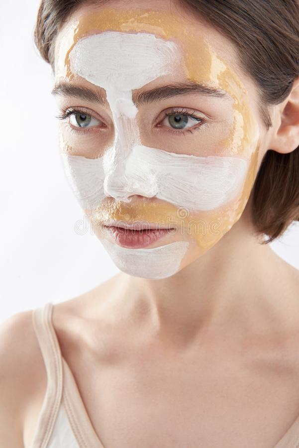 Portrait of young pretty woman with face mask royalty free stock photography
