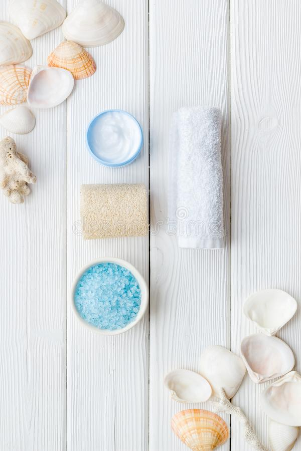 Cosmetics with Dead Sea minerals and shells on white wooden background top view royalty free stock photos