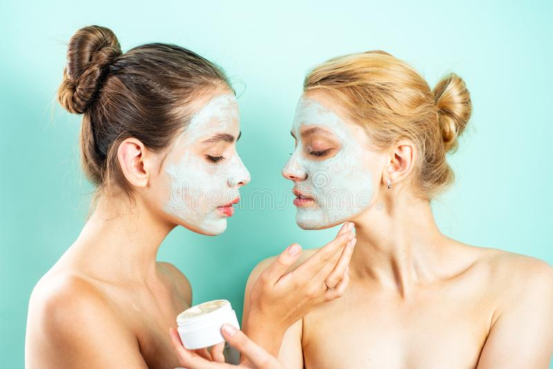 Skin care concept. Face cream. Portrait Of two Beautiful Young Female Models With Natural Facial Makeup. royalty free stock photo