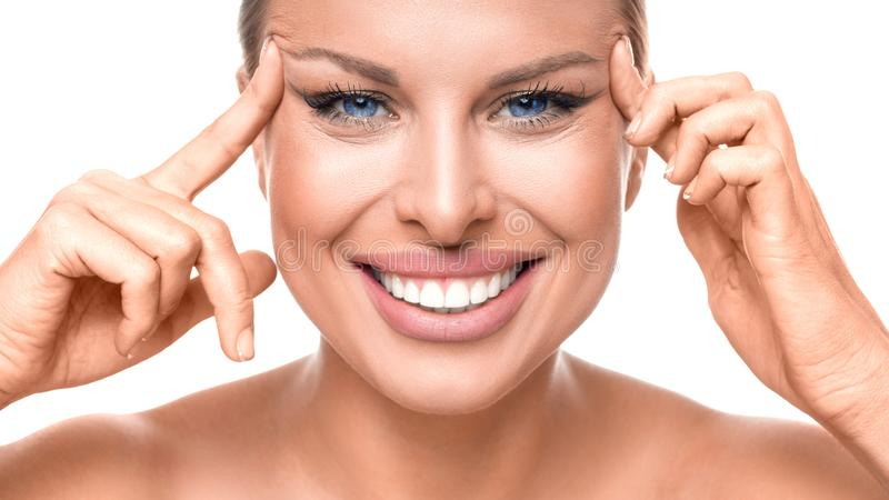 Skin care concept. Happy woman touchig her face by fingers. stock photos