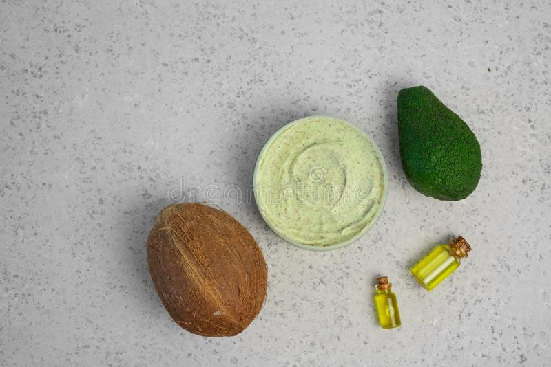Skin care natural products ingredients for scrub body mask: Avocado, coffee, coconut, oil.  stock photo