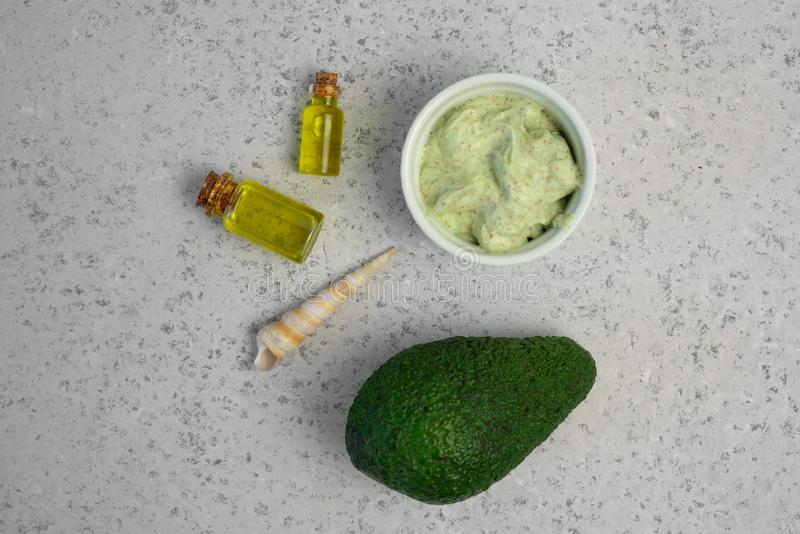 Skin care natural products ingredients for scrub body mask: Avocado, coffee, coconut, oil.  stock photos
