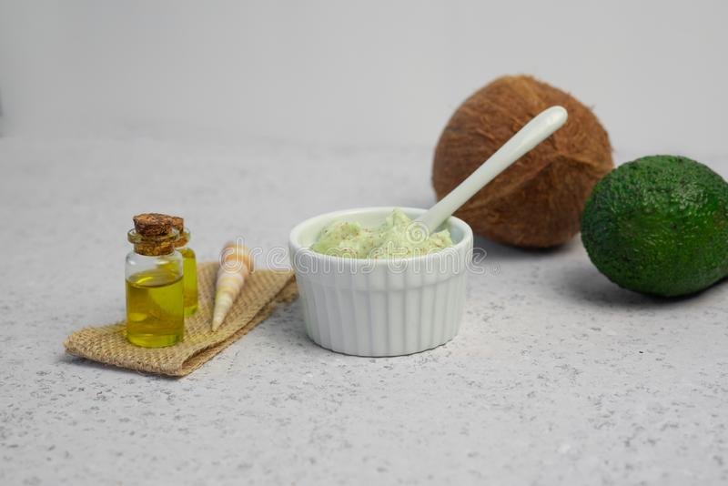 Skin care natural products ingredients for scrub body mask: Avocado, coffee, coconut, oil.  royalty free stock photo