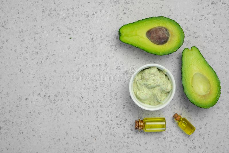 Skin care natural products ingredients for scrub body mask: Avocado, coffee, coconut, oil.  royalty free stock image