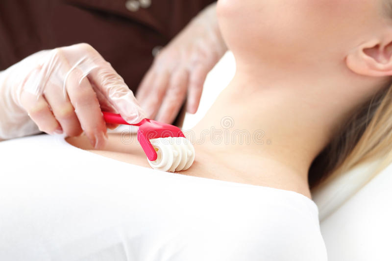 Skin care of the neck. And cleavage. Massage in the beauty salon stock images