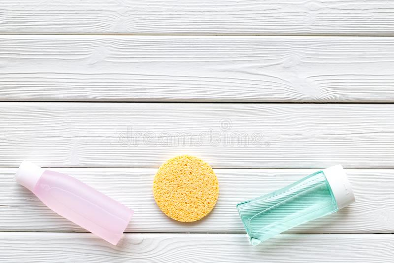 Skin care cosmetics with facial tonic, mycelial water and sponge on white wooden background top view mockup. Skin care organic cosmetics with facial tonic bottle stock photography