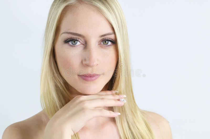 Skin care - Portrait of a beautiful young woman. Portrait of a beautiful young woman over a white background stock photo