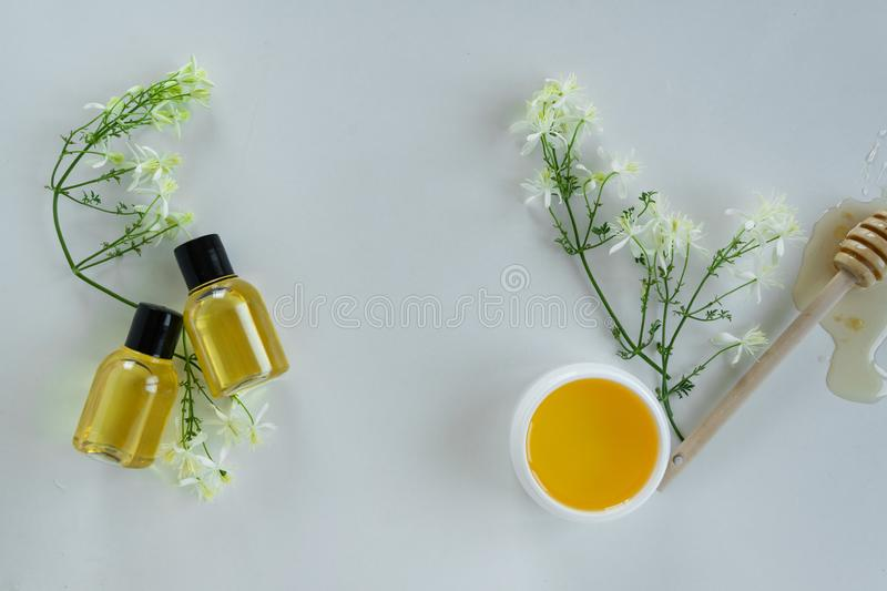 Skin care products with extract of honey and wild flowers. Healthy organic remedy. Superfood for the skin stock photo