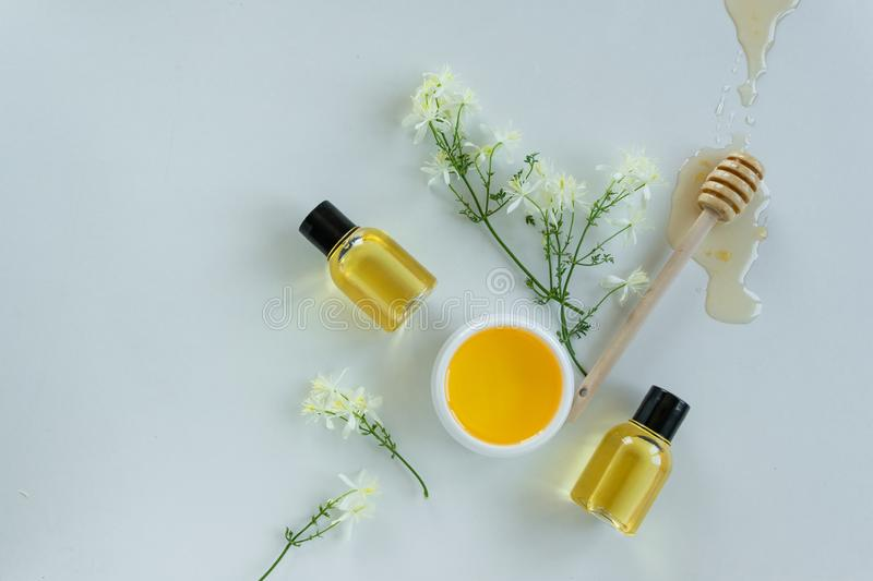 Skin care products with extract of honey and wild flowers. Healthy organic remedy. Superfood for the skin royalty free stock photos
