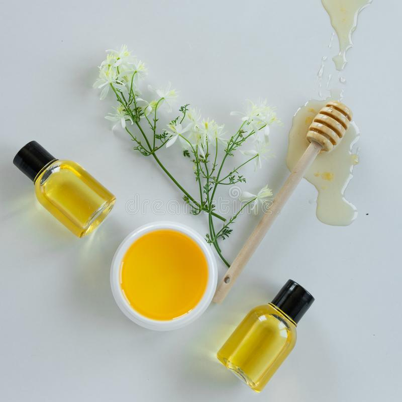 Skin care products with extract of honey and wild flowers. Healthy organic remedy. Superfood for the skin stock images