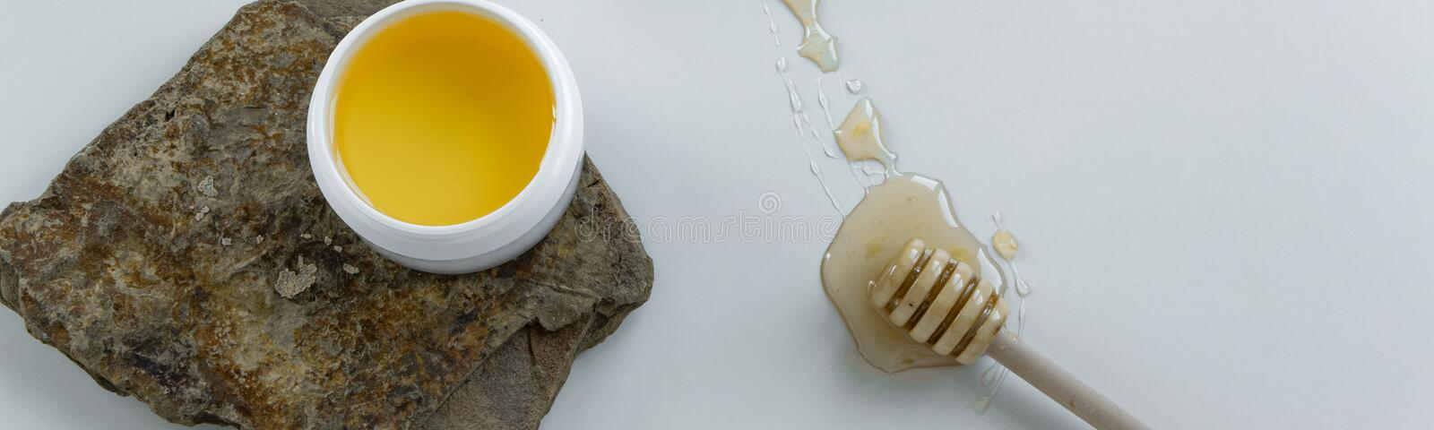 Skin care products with honey. Healthy organic remedy. Superfood for the skin royalty free stock photo