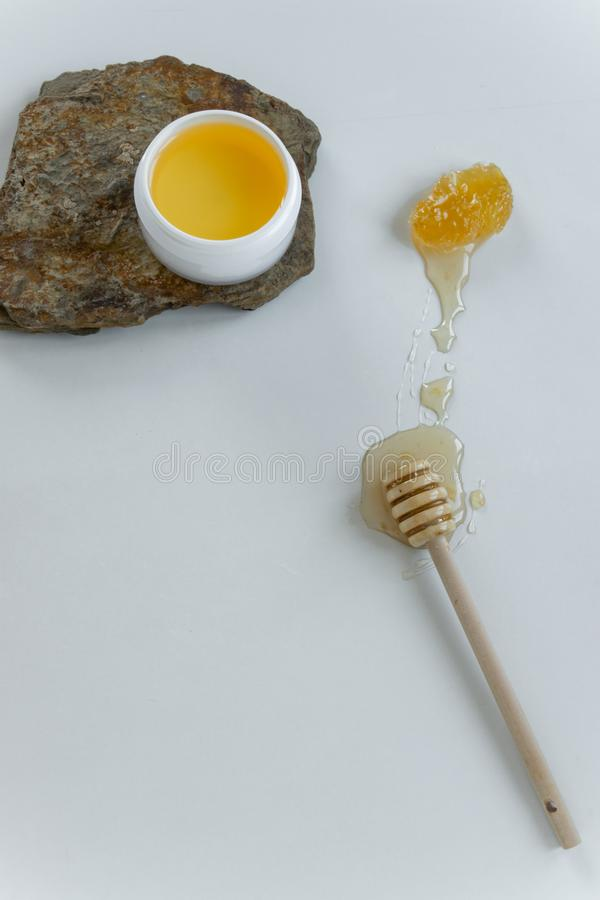 Skin care products with honey. Healthy organic remedy. Superfood for the skin stock photography