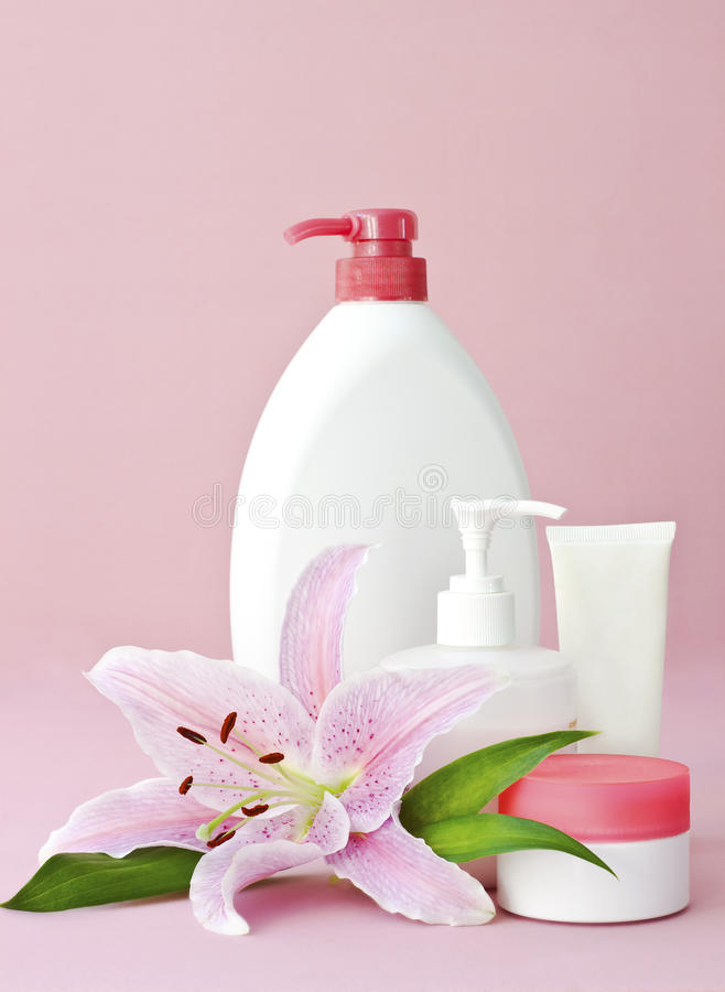 Skin care products on pink royalty free stock photography