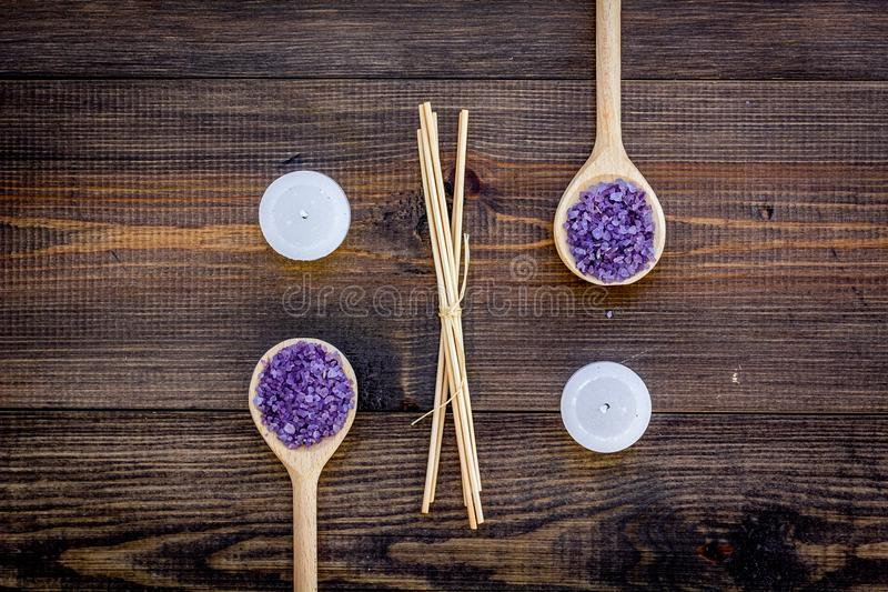 Skin care and relax. Cosmetics and aromatherapy concept. Lavender spa salt on dark wooden background top view.  royalty free stock photos