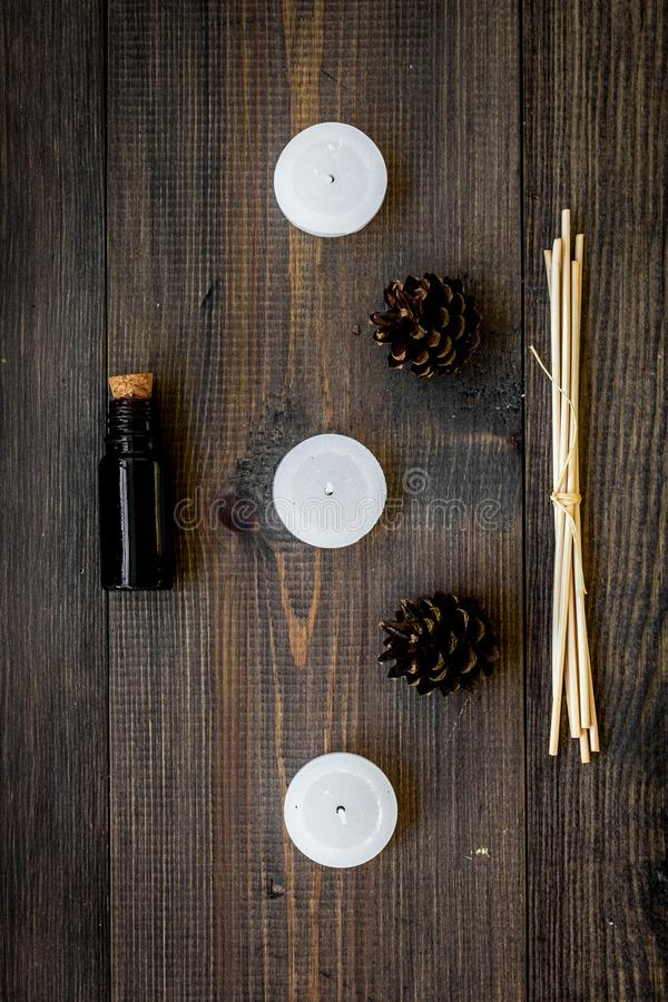 Skin care and relax. Cosmetics and aromatherapy concept. Pine oil on dark wooden background top view.  stock image