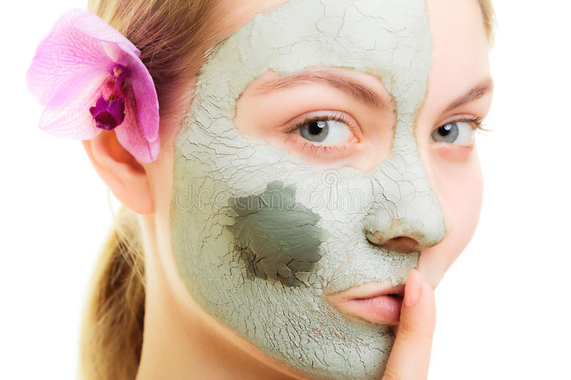 Skin care. Woman in clay mud mask on face. Beauty. Skin care. Woman in clay mud mask on face with finger on lips isolated on white. Girl taking care of dry royalty free stock photos