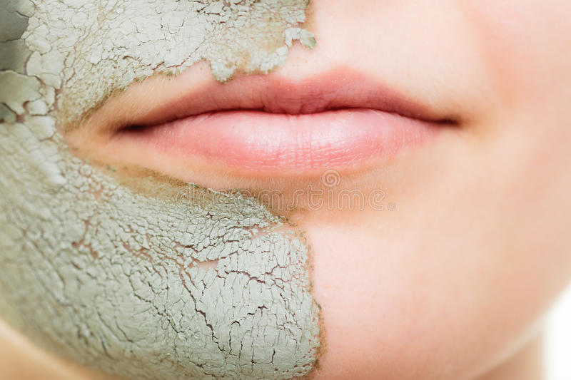 Skin care. Woman in clay mud mask on face. Beauty. Skin care. Woman in clay mud mask on face isolated on white. Girl taking care of dry complexion. Beauty stock photo