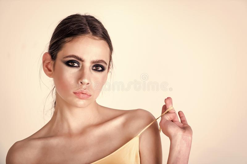Skin care. Woman or girl with makeup face pull strap over shoulder stock images