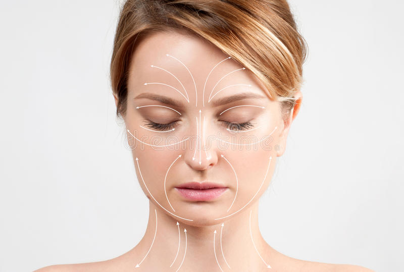 Skin Care. Woman with perfectly clean skin and massage facial lines royalty free stock photography