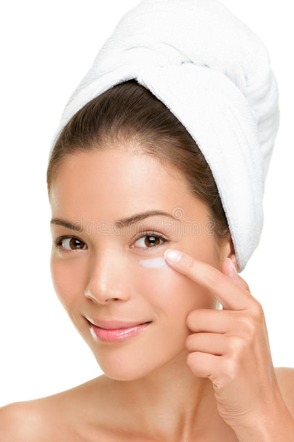 Skin care woman putting face cream royalty free stock photography