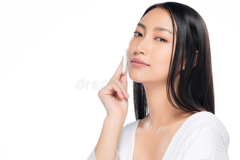 Skin care woman removing face makeup with cotton swab pad stock photography