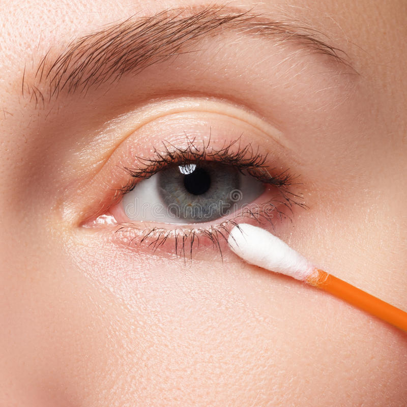 Skin care woman removing face makeup with cotton swab. Skin care concept. Caucasian model with perfect skin. Beauty & Spa. stock photo