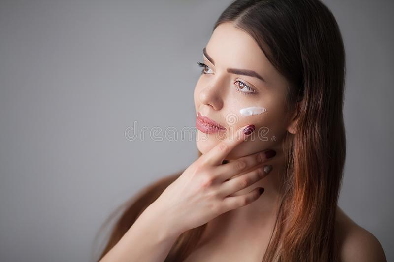 Skin care woman removing face makeup - skin care concept / photo. S of appealing brunette girl royalty free stock photography