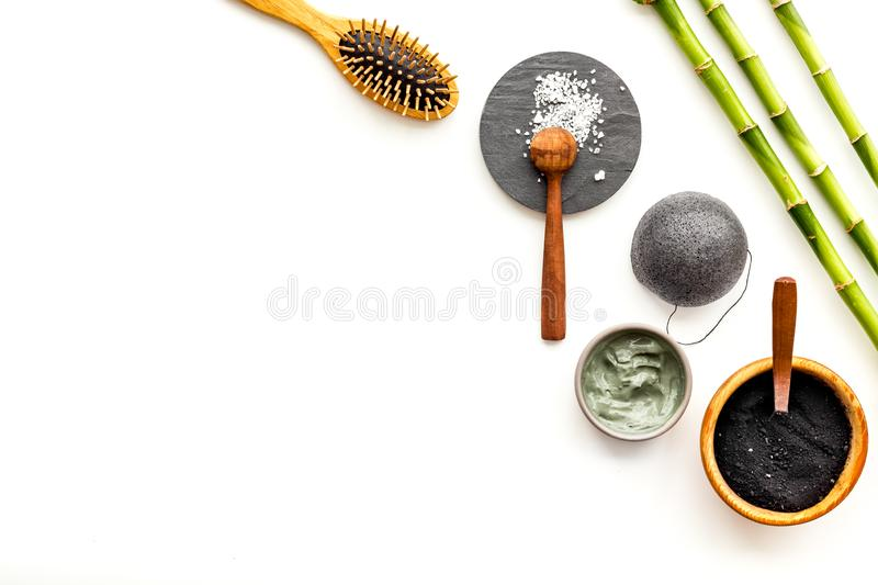 Skin cleansing and detox. Bamboo charcoal powder cosmetics on white background top view copy space stock image