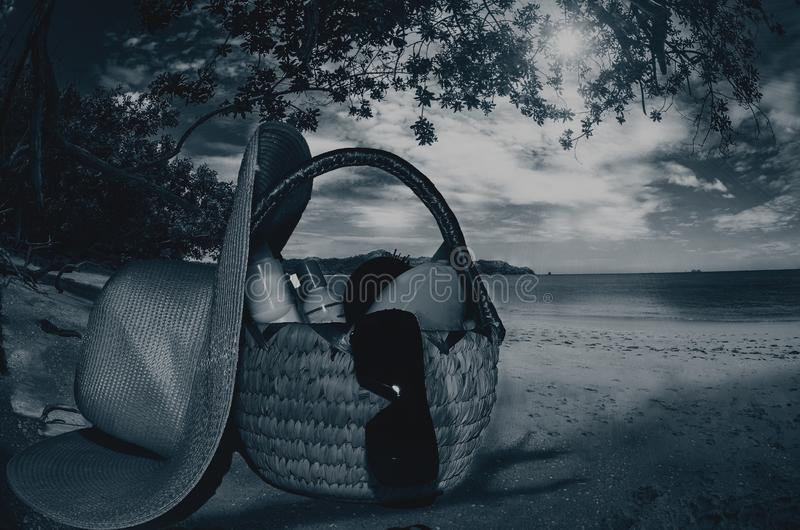 Skin creams and all utensils in a basket on the beach in the evenings. Photographed on marzo 2019 royalty free stock images