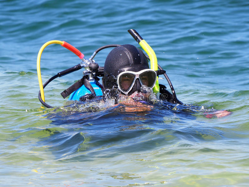 Skin Diver Surfacing after Diving stock image