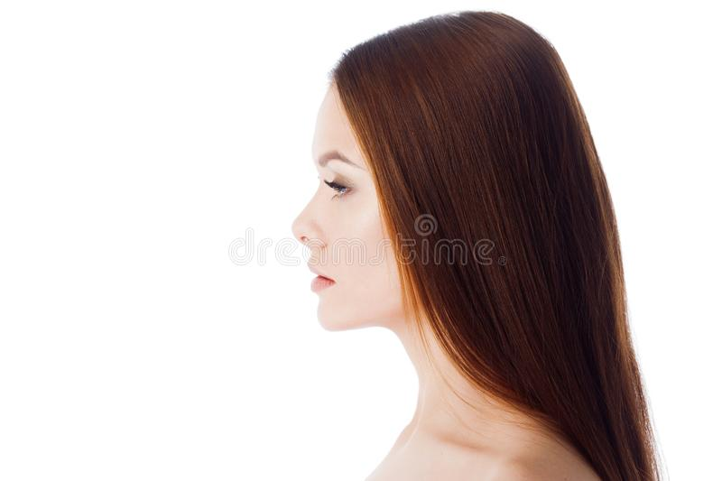 Skin and hair care. Portrait of a young beautiful woman with clean and healthy skin. stock photo