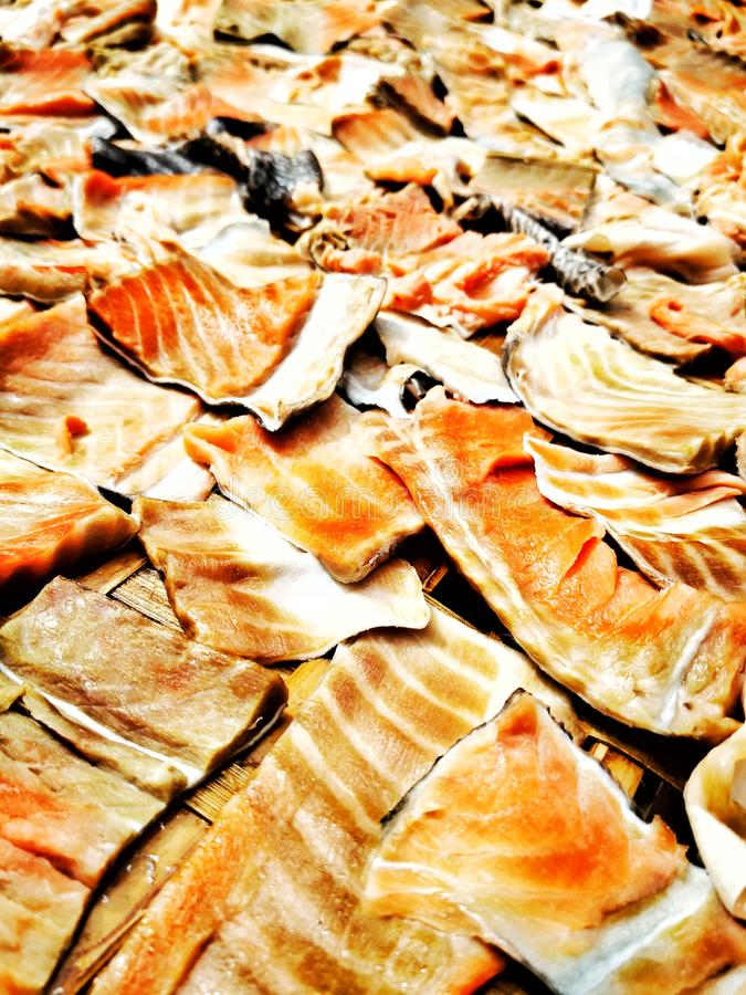The skin of salmon. The skin of salmon has been sliced to the sun and dried. To assemble the food in different way stock images