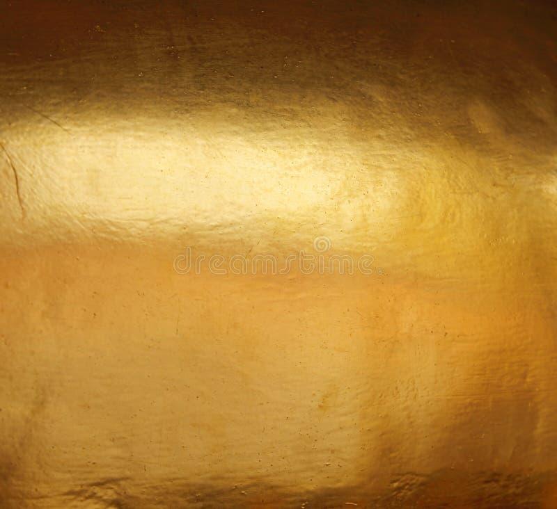 Skinande gul bakgrund för textur för guld- folie för blad royaltyfri fotografi