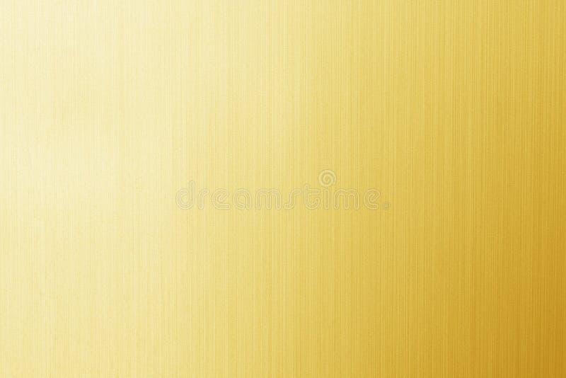 Skinande gul bladguldfolietextur arkivfoto