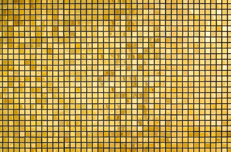 Skinande guld- fyrkant, guld- bakgrund för ljus abstrakt mosaik med glansen, idérikt abstrakt begrepp fotografering för bildbyråer
