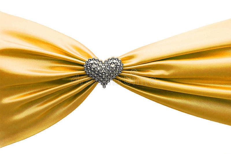 Skinande guld- satängband och diamanthjärta arkivfoto
