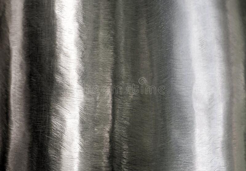Skinande yttersida och skrapat på rostfritt stål arkivbilder