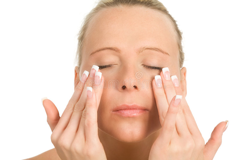 Skincare. A beatiful woman creaming her face stock photo