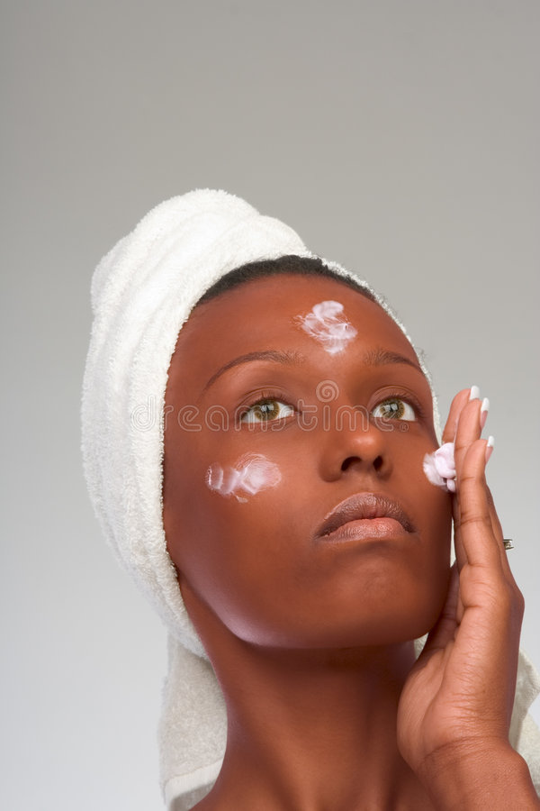 Skincare of balck woman in towel stock photography